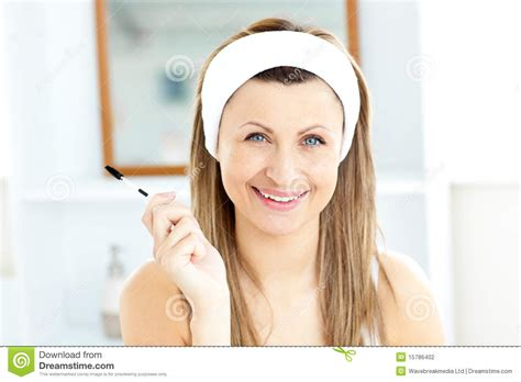 women using the bathroom radiant young woman using mascara in the bathroom stock photography image 15786402