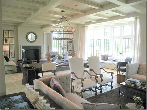 seating areas in living room a look at the entire room with the two seating areas and the dining table in between at the