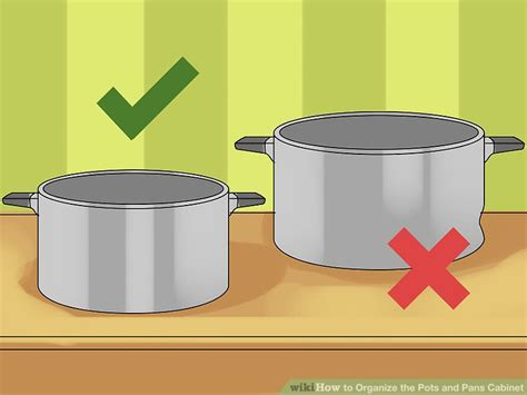 organize pots and pans how to organize the pots and pans cabinet 14 steps