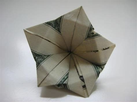 Origami Flower From Dollar Bill - in asian folklore the plumeria is believed to house