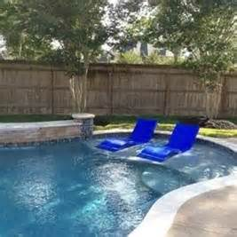 Backyard Pool Landscaping Ideas A Inground Pool With Tanning Ledge Designs Bing Images
