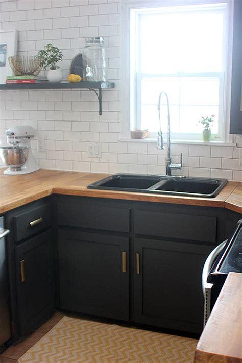 dark grey kitchen cabinets with black countertops dark grey cabinets and wooden countertops sophie leger s