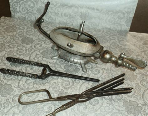 vintage hairstyles curling iron first curling iron and heater vintage hair pinterest