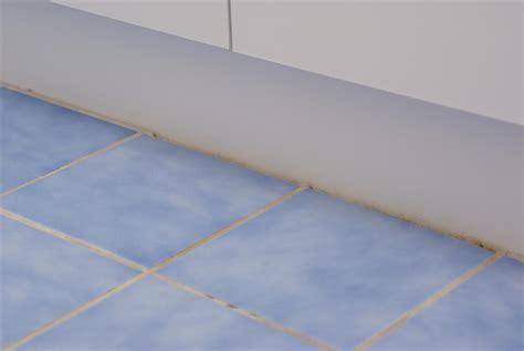 do you tile under kitchen cabinets should you tile under bathroom vanities or kitchen
