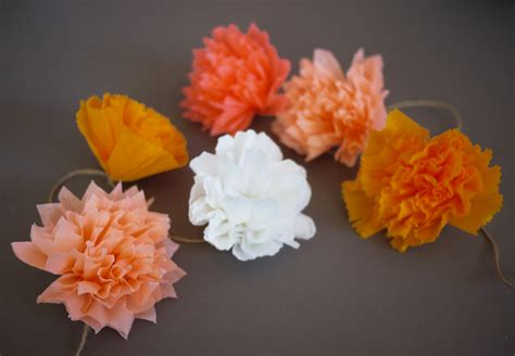 How To Make Paper Pom Pom Garland - diy crepe paper pom pom garland
