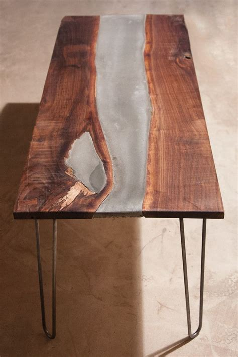 custom concrete table got a bit experimental with this table walnut slab with