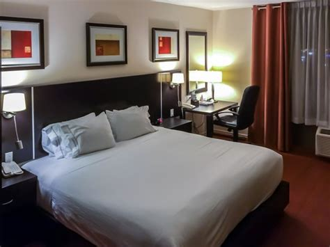 bedroom expressions locations king bed with plenty of lights nice sheets picture of