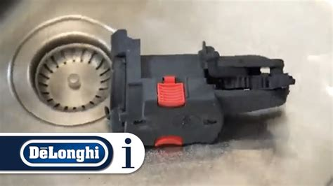 how to clean the infuser on your de longhi magnifica s ecam 23 260 coffee machine