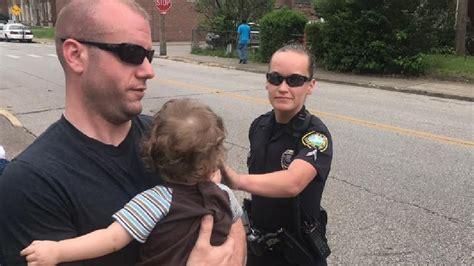 comfort officer charleston police officers comfort children after mother
