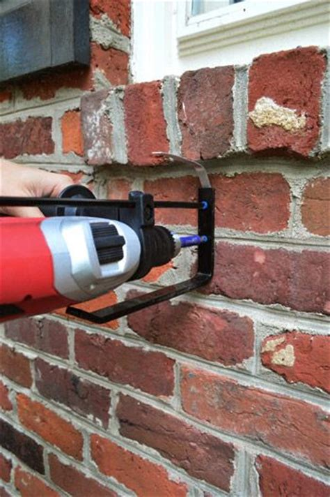 how to hang a picture on a brick wall pinterest