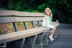 girl sitting on a bench lonely girl sitting on park bench stock photo getty images