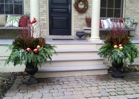 christmas decorating huge stone urns in front of entrance winter containers traditional exterior toronto by earth and sole