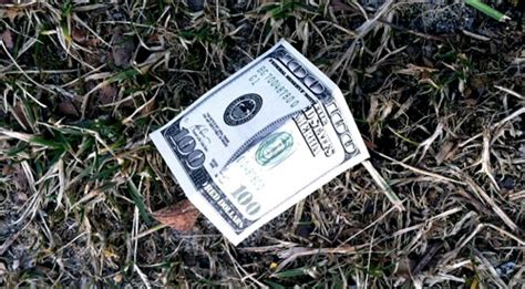 folded 100 dollar bill business card new dollar finding and real money on the ground budgets are