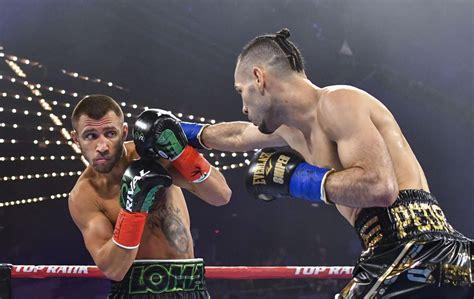 lomachenko wins unanimous decision   lightweight belt