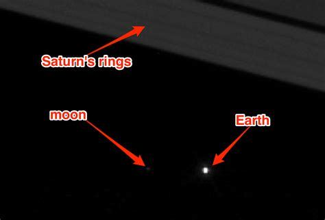nasa pictures saturn new nasa photo shows earth and the moon through saturn s