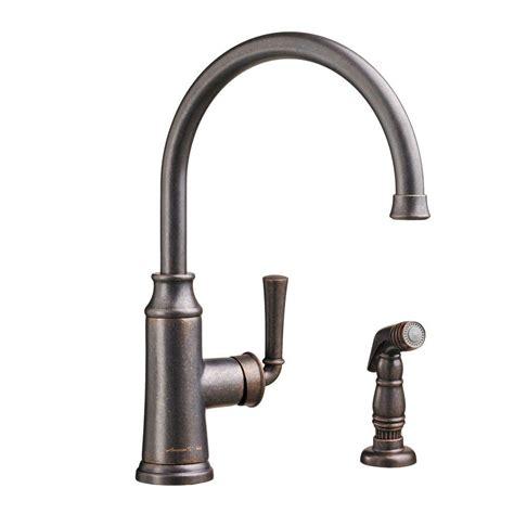 bronze kitchen faucet with sprayer
