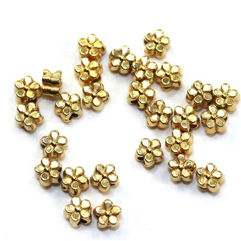 gold tiny metal flower spacer bead