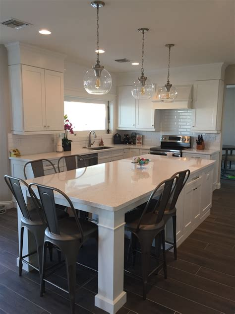 kitchen island with table seating white shaker waypoint cabinets designed by nathan hoffman