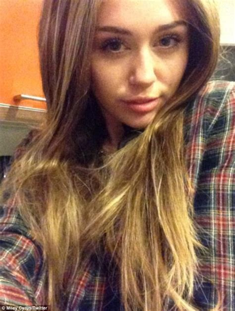 Miley Cyrus shows off long tresses, but it's just for