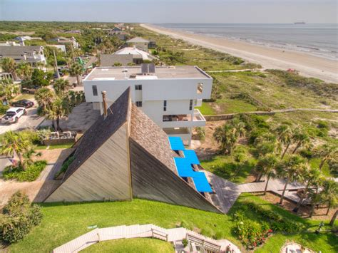 home by morgan design group triangular beachfront home is a dreamy retreat buried in