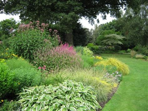 mixed border planting style typical mixed border plants weigela euonymus ornamental grasses