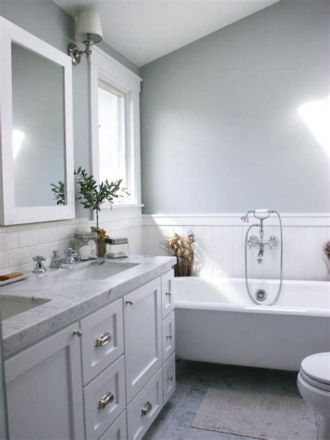 white bathtub backsplash tile mirror  window frame