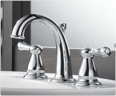 chrome bathroom faucet delta 3575lf leland two handle widespread lavatory faucet