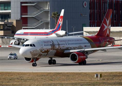 alitalia considers buying stake in air malta reuters