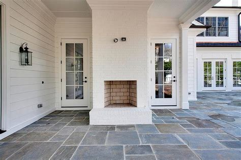 floor charcoal brick fireplace painted covered patio with white brick fireplace transitional