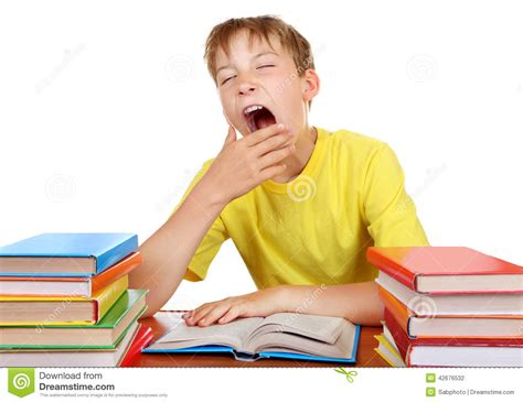 kid at desk tired schoolboy yawning stock photo image of pile isolated 42676532