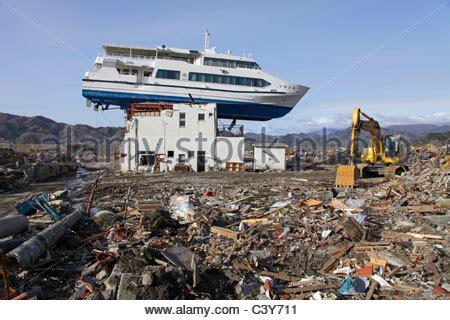 boat on building japan tsunami building destroyed by tsunami iwate japan stock photo