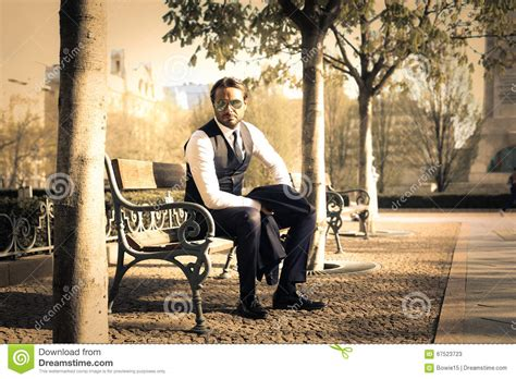 bench manly man sitting on a bench stock photo image 67523723