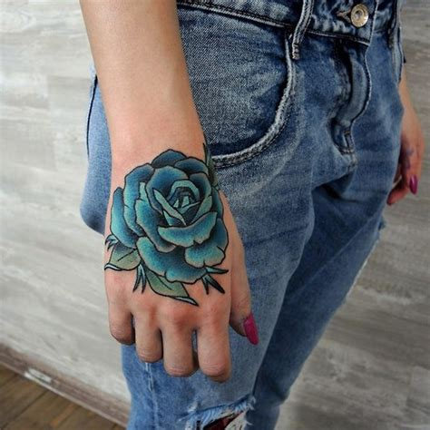 tattoo on my hand blue rose flower tattoo on the back of hand best tattoo