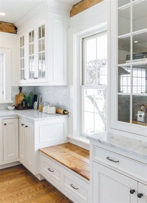 love the window seat under low window to keep cabinets