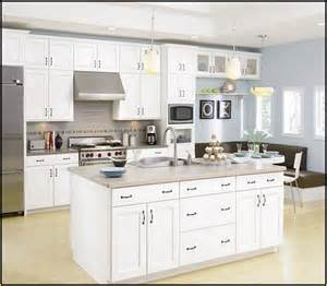 kitchen with white cabinets and walls home design ideas