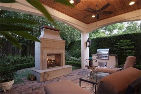houston patio covers with a cedar ceiling fireplace