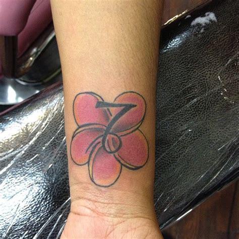 capricorn tattoos for wrist capricorn zodiac flower on wrist tattooshunt