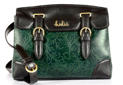 Golden Fancy Sling Bag holii introduces emeralds in the sun sector communique