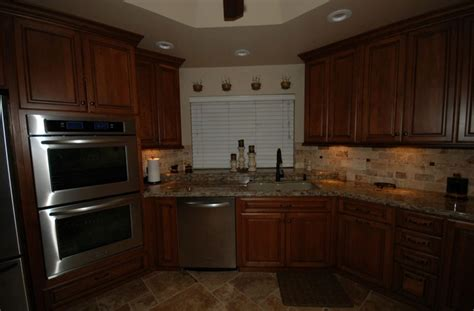 cambria kitchen cabinets starmark cherry cabinets with harvest stain and chocolate