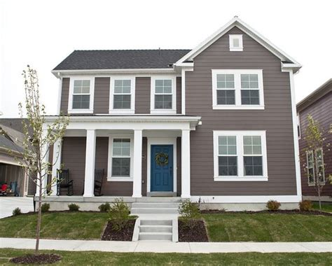 blue house white trim front door blue door white trim smokey gray brown siding love the