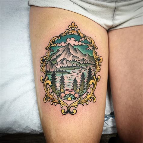 family tattoo round lake frame with mountain and lake scene inside color tattoo