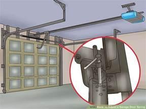 How To Tighten Garage Door Springs by How To Adjust A Garage Door With Pictures Wikihow
