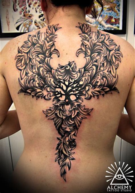 intricate phoenix tattoo with tree of life