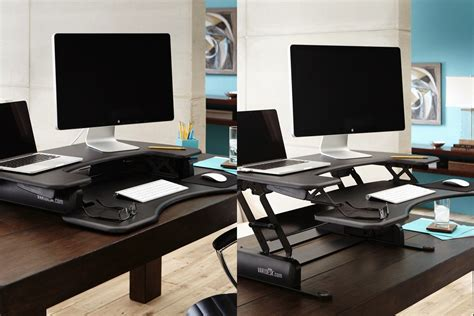 convert desk to standing gear guide create a healthy workspace with these 9 tools