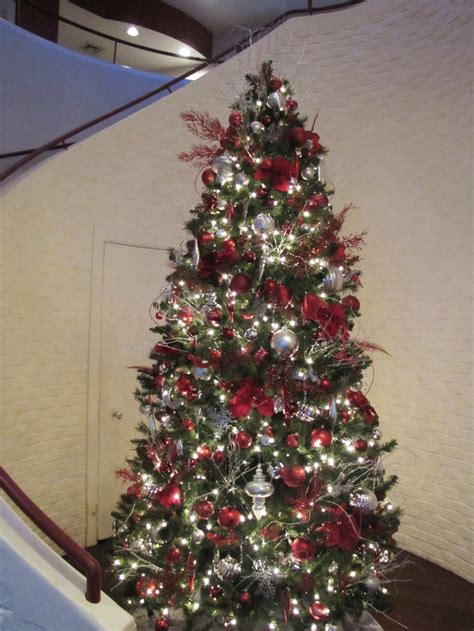 9 silver christmas tree an and silver tree complements the and white spiral staircase located