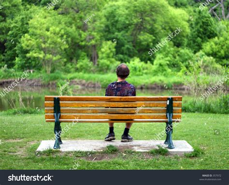 person sitting on a bench man sitting on bench stock photo 357972 shutterstock