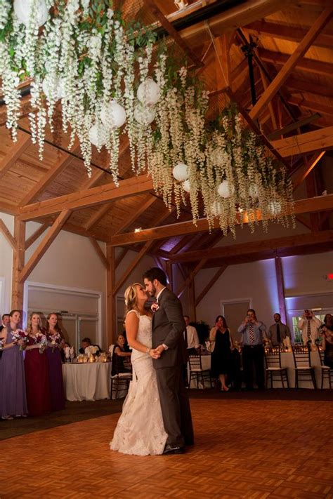 Rustic Tablescapes wisteria hanging flowers with lanterns over dance floor