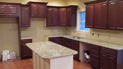 walk through kitchen designs job walk through oak cabinets with painted island by