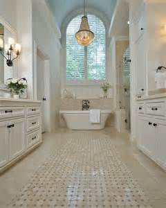 All white master bathroom with chandelier and bathtub white dominates