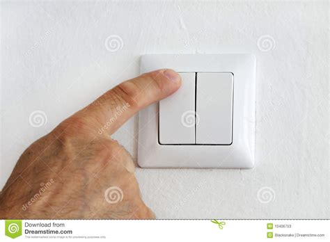 finger at electric light switch stock image image 10406753